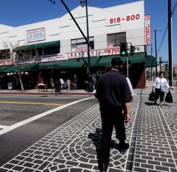 man crossing street