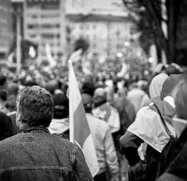 Black and white photo of people peacefully walking in the streets